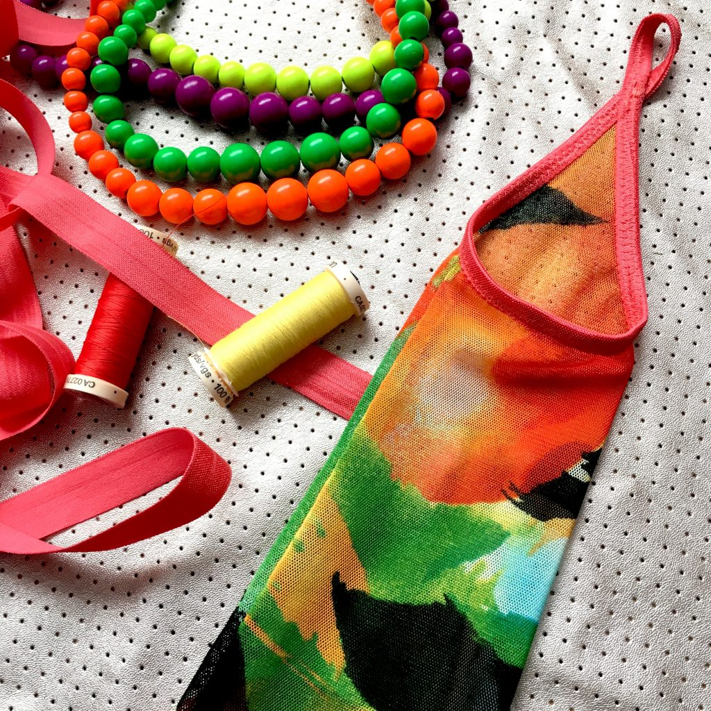 The Classic Palm Gauntlet styled in a brightly coloured tropical print